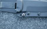 Adjustable tension screw on ESEE 5 sheath
